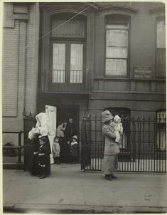 Happy Mother's Day!  - Mothers and their children leaving West Side Day Nursery and Industrial School, New York City, ca. 1901s.