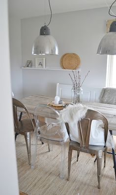 A simple dining room with big accent lamps to and some whimsy. Room Interior Design, Dining Room Design, Dining Room Furniture, Home Furniture, Furniture Design, Rooms Home Decor, Decor Room, Woven Dining Chairs, Metal Chairs