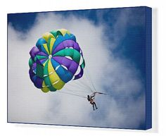 Parachutist with colourful parachute Canvas Artwork from $129.99