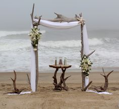 Standard Driftwood Arch with added driftwood accents and florals!