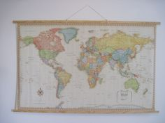 How to hang a map, vintagestyle. This is great because I HAVE a map that's huge and it looks awful right now...I've been looking for an idea of how to hang it without buying a huge frame - this works GREAT!