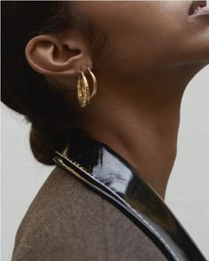 Love the gold jewelry with the glossy patent collar.