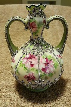 Beautiful Nippon hand painted vase with moriage detailing.