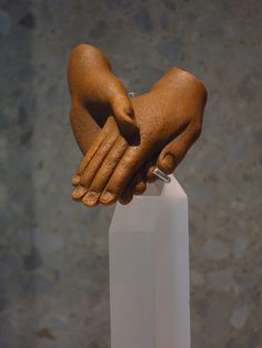 All that remains from a statue of Akhenaten & Nefertiti is their clasped hands.  New Kingdom, Dynasty 18  --  Circa 1350 BCE  --  Armana, Egypt  --  The Neues Museum, Berlin