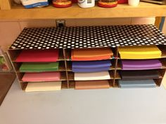 Homemade construction paper sorter. Made from flat rate USPS boxes, duct tape, and wrapping paper!