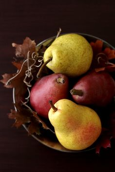 Bowl of pears and autumn leaves for a Fall inspired table centerpiece.