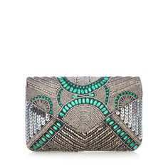 From the 'Nine' collection by Savannah Miller, this clutch bag is ideal for introducing Twenties-inspired charm to an accessory collection with Art Deco glamour. Featuring delicate beading with eye-catching green jewelled detailing, this effortlessly chic piece has a chain shoulder strap and is ideal for teaming with evening looks.