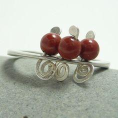 Coral spiral ring with red jasper gemstones