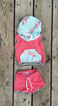 Summer is coming! Super cute flamingo hoodie and shortie shorts for your baby girl! Definite summer colors rocking this sweet set; coral shortie