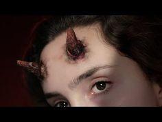 Devil horns. Packing peanuts, eyelash glue. Or Cotton balls and nail polish horns. YouTube