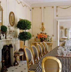Mimmi O'Connell ~ A set of black and white striped Louis XVI style dining chairs dominates this dining room which features hand-painted trompe l'oeil wall panels