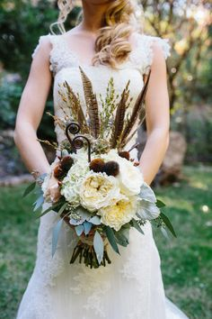 feather + white flower wedding bouquet // photo by Marianne Wilson // flowers by Rhonda Fauci