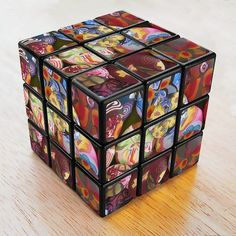 how cool is this? a polymer clay rubix cube or cut a picture into nine squares and glue on one side