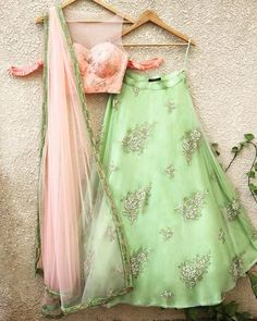 Peach Blouse with Gota Work and pleat cold shoulder detail teamed with Pista Green Buti Lehenga on Net with Raw Silk Underlay and Peach Dupatta with BeadworkComposition : Georgette, Net and Raw SilkAll products can be customised for sleeves, le. Half Saree Lehenga, Green Lehenga, Lehenga Skirt, Lehnga Dress, Lehenga Blouse, Indian Lehenga, Ghagra Choli, Kids Lehenga Choli, Floral Lehenga