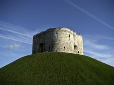 Did you know that the #Clifford'sTower was twice burned to the ground, before being rebuilt by Henry III in the 13th century? If you are planning to visit, then stay close to this place and  book #HolidayInnExpressYork and enjoy a complimentary continental #breakfast with hot items, complimentary parking included in all bedroom rates. http://bit.ly/1JMOsqA