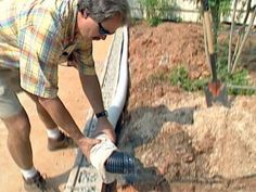 A retaining wall that has a slope dropping to it will need additional drainage at the base. Add gravel and a fabric-covered drainage pipe at the base. The fabric will help prevent clogging of the pipe Retaining Wall Drainage, Retaining Wall Patio, Building A Retaining Wall, Concrete Retaining Walls, Drainage Pipe, Concrete Blocks, Paver Walkway, Concrete Stairs, Concrete Patio