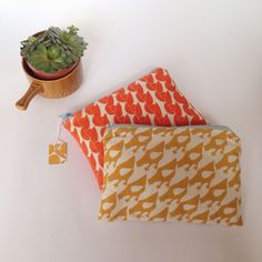 Screen printed 'Little Chicken' and 'Greengage' pouch in mustard yellow and tangerine 🍊
