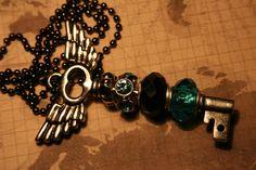 Bejeweled key pendant via Etsy -- I ordered an orange one!