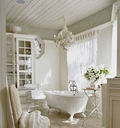 love it all. Gray beadboard ceiling, chandy over clawfoot tub, armoire for storage.