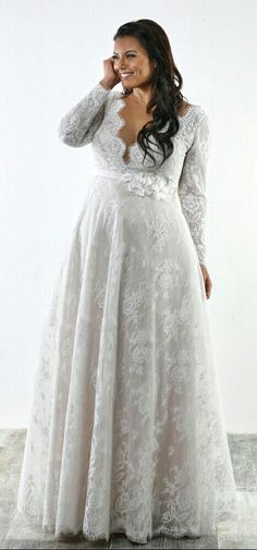 Plus size french lace A line bridal gown with long sleeves. Sophia. Studio Levana