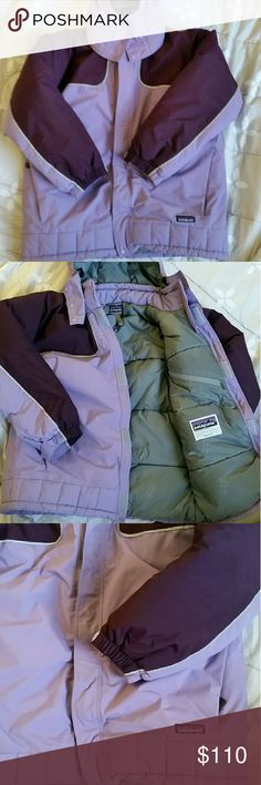 Patagonia purple eomans ski jacket coat puffer Vintage purple Patagonia ski coat in good condition not for sure the size since the tag was taken out I would say it was probably a medium measurements are from collar to hem, length is  26 inches,totalling 50 inches all around  from neck collar to sleeve is 29 inches  comes from smoke-free home Patagonia Jackets & Coats Puffers