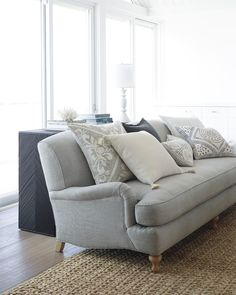 This casual sofa with T shaped cushions is effortlessly chic. Customized in a neutral tone and paired with a natural fiber rug, it can bring an elegant, yet earthy feel to your living room. Sofa Design, Canapé Design, Coastal Living Rooms, Living Room Modern, Living Room Designs, Small Living, Sofa Styling, Living Room Seating, Family Room Design