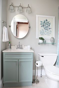 Bathroom - mushroom grey walls, nickel fixtures and accessories, soft blue cabinet, floral art