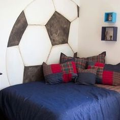 I could see this treatment done on a bed wall with moulding and accent paint to create soccer ball pattern