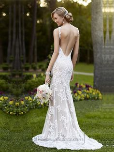 Inspired by the world\'s hottest red carpet trends, this wedding dresses are handcrafted with stunning detail and sparkle that stand the test of time. This Lace over Lustre Satin sheath dress features beautiful vine shoulder straps, a low back with a zipper closure, and a sweep train. You\'ll love how the Lace embroidered bodice hugs your curves, while the V neckline frames your face.