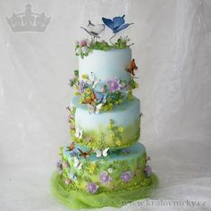 Wedding cake prepared for contest in Brno. Theme: Wedding on the meadow, cake decorated with various sorts of meadow flowers and with dancing butterflies of various sorts. All decorations made from sugar paste. Colored by airbrush, gel and dust...
