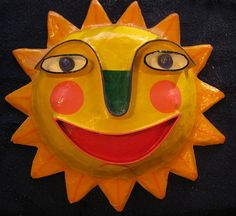 Beaming-sun paper mache mask by forestelf_2000, via Flickr