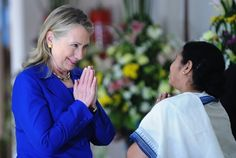 "Hilary Clinton delivers a traditional ""namaste"" greeting to Mamata Banerjee, Chief Minister of West Bengal."