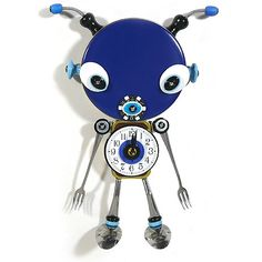 Culinary Creature Clock Sculpture : Martian Culinary objects discover new life as a work of imaginative functional art that is out of this world. Handmade with reclaimed earthly treasures, the sculptural martian wall clock provides the perfect touch of unconventional merriment! A blue metal container serves as the oversized martian head, a recycled Altoids tin as the body, and reclaimed stainless steel silverware forms the legs and elongated arms.