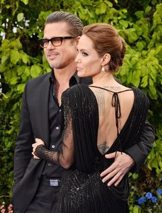 Pin for Later: The 45 Sweetest, Sexiest Celebrity PDA Moments of 2014 Brad Pitt and Angelina Jolie