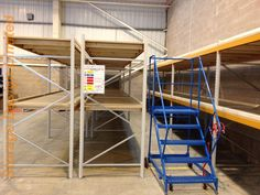 Apex Longspan Shelving being accessed by mobile safety steps