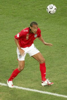 Rio Ferdinand of England in action at the 2006 World Cup Finals. 2006 World Cup Final, Rio Ferdinand, Finals, England, Action, Football, Running, Soccer, Group Action