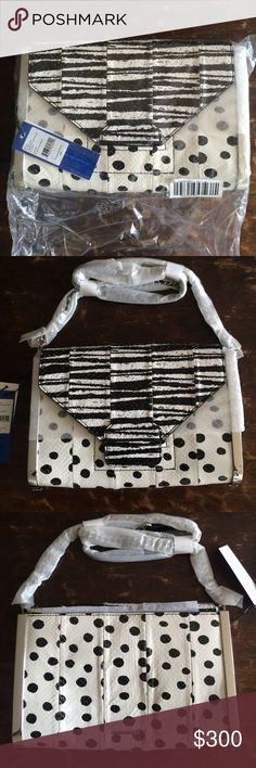 Argentina Envelope Clutch This is a gorgeous, never used, still wrapped in its original plastic covers, luxe watersnake and tough silver hardware envelope purse. It is both striped and polka dotted black and white patterns are both classic yet incredibly modern with the quality and type of material that you can dress up or down for any occasion. It comes with a dustbag for careful storage, and a removable chain for the option of wearing as a purse or a clutch. Rebecca Minkoff Bags Clutches…