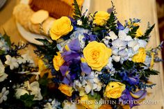 Bridesmaid bouquet with yellow roses and blue irises from Colonial Florist, Dracut, MA.  Click here for more detail wedding photographs from http://www.kristingriffinphotography.com.