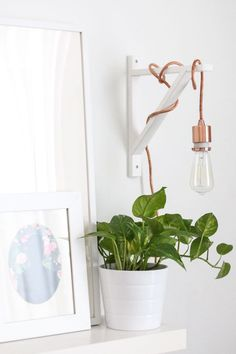 like this basic pendent lamp hanging from plain wall bracket