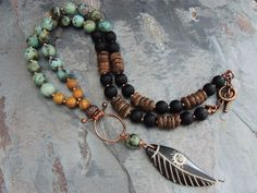 Beaded Tribal Necklace, Carved Bone Feather Pendant, Boho Necklace, Sun Design by ATwistOfWhimsy on Etsy https://www.etsy.com/listing/225114344/beaded-tribal-necklace-carved-bone