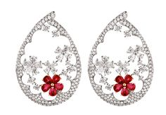 Oval: Diamonds and rubies set in 18 carat white gold by Entice. To view, visit: http://www.vogue.in/content/z-fine-jewellery#15