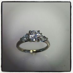 Custom made  Center diamond round brilliant  complimented with two pear shapes