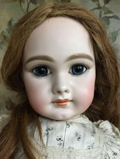 Very beautiful Dep Jumeau bebe with most expressive large blue eyes and sweet closed mouth. Pale bisque and delicate coloring. Her bisque head is free