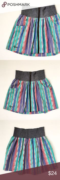 Ezekiel Stripe Mini Skirt with Wide Elastic Waist 100% cotton. Navajo stripe. Wide elastic smocked waist, 3 3/4 inches wide. Chunky exposed front zipper. Waist: 12 inches across, stretches to 15 inches across. Length: front 16 inches, back 17.5 inches. Colors mint lilac soft red yellow cream gray blue. This item is used and in good condition, no issues.❤️ Ezekiel Skirts Mini