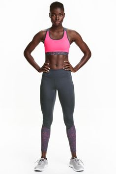 Sports tights: Sports tights in fast-drying functional fabric with wide ribbing that holds in and shapes the waist and a concealed mesh key pocket in the waistband.