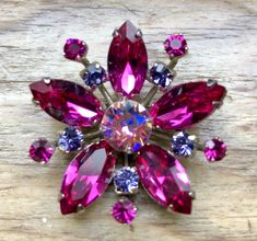 Sherman Brooch with Fuchsia & tanzanite , rhodium plated .