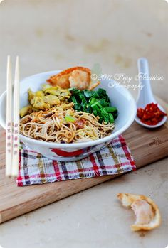 Indonesian Yellow Chicken Noodle completed with fried wonton.
