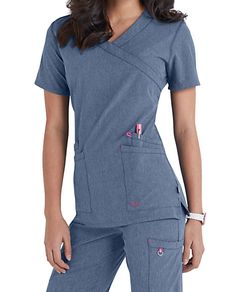 Go glam with Smitten's Glam crossover V-neck scrub top. This polyester/spandex top features curved-top pockets with double entry, and they include an instrument divider and contrast bungee loop for specialized storage. Bust darts ensure a divine fit, while side slits provide room for easy maneuverability. Smitten Glam Crossover Scrub Tops V-neck, crossover type 4 pockets: 2 double-top entry with instrument divider Bust darts Side slits All colors are 87% polyester/...