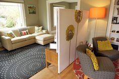 Love the room divider idea- 2 different canvas' one to the floor