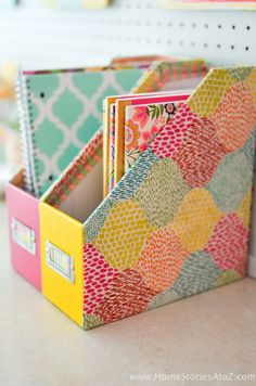 Great tutorial! Dress up plain magazine files with Mod Podge and fabric.
